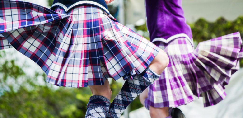 Two Highland dancers doing a fling