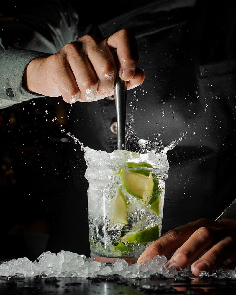 A barman making a Caipirinha cocktail