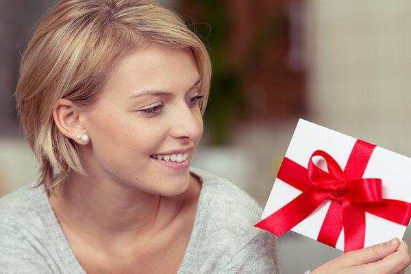 A girl receiving a gift voucher