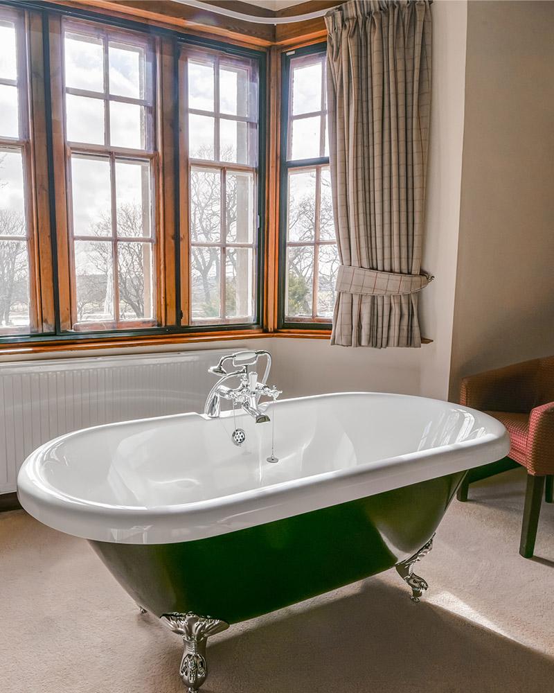 A roll top bath in a bay window in Langhills self catering belonging to Mackays Hotel in Wick